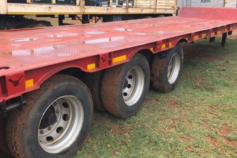 TRI AXLE LOWBED TRAILER Trucks