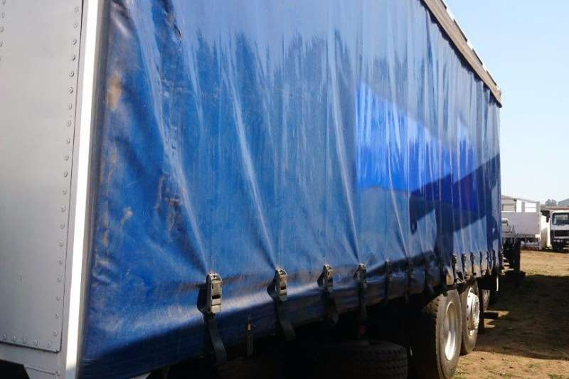 MAN Curtain side MAN 15.220 with Tag Axel Truck
