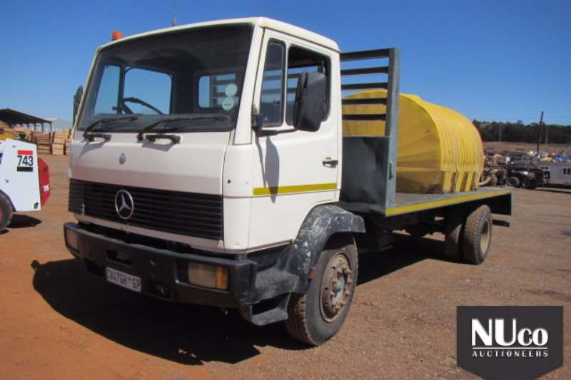 Truck Mercedes Benz Flat Deck MERCEDES BENZ 1014 FLAT DECK WITH WATER TANK 0