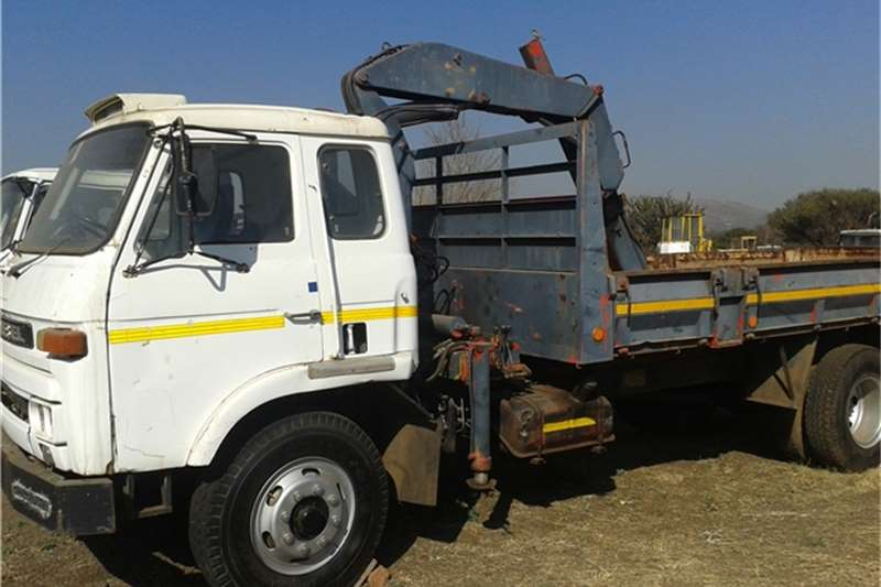 Truck Nissan Dropside CK 10 WITH CRANE 1980