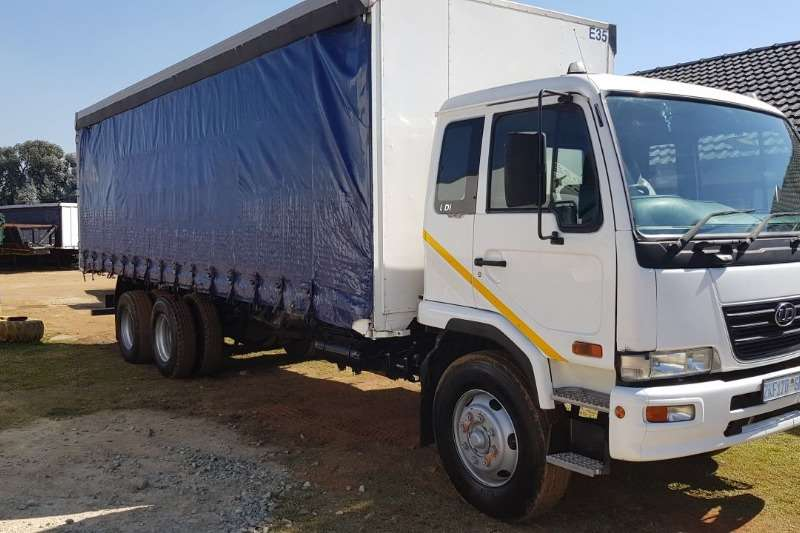Nissan Nissan UD 100 Tag Axle curtain side truck