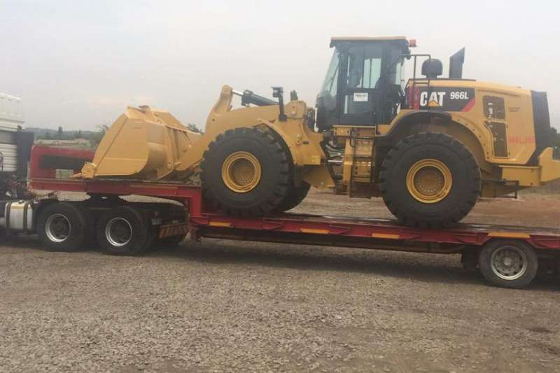 CAT Transport of all plant and machinery Front end loader