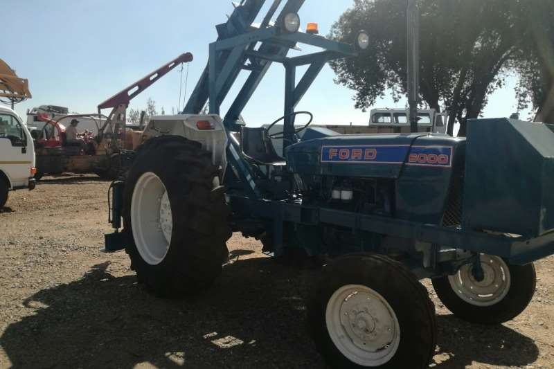 Ford Ford 6000 with Auger attachment Tractors