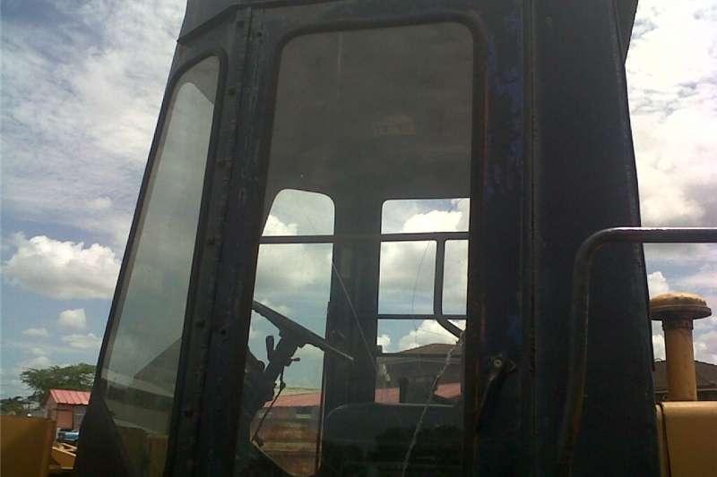 Digging Komatsu WA120 front end loader Front end loader