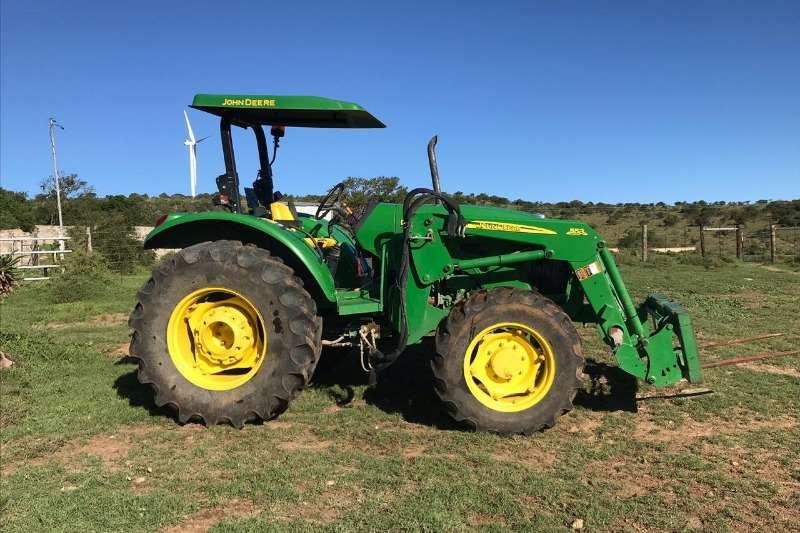 John Deere Four wheel drive tractors John Deere 5090 E + John Deere 553 Loader Tractors