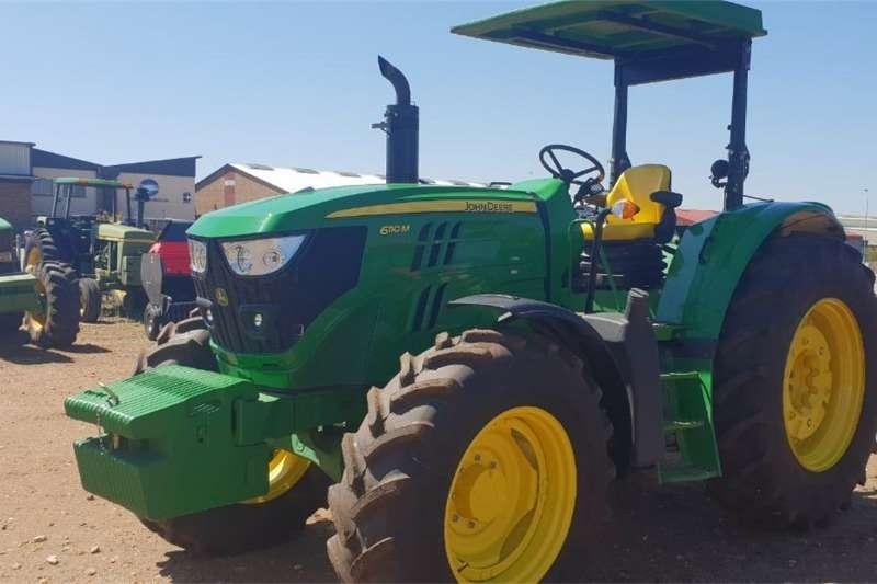 John Deere Four wheel drive tractors John Deere 6110 M Tractors