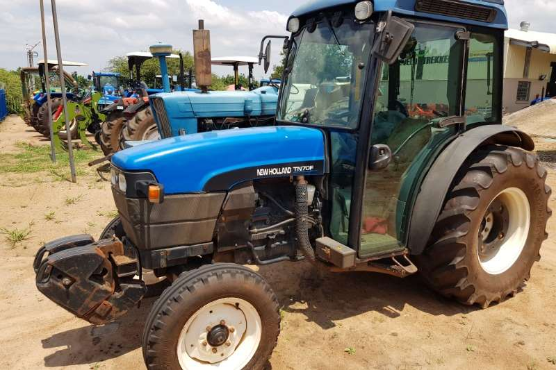 New Holland Tractors Compact Tractors New Holland TN 70 F Cab 2009