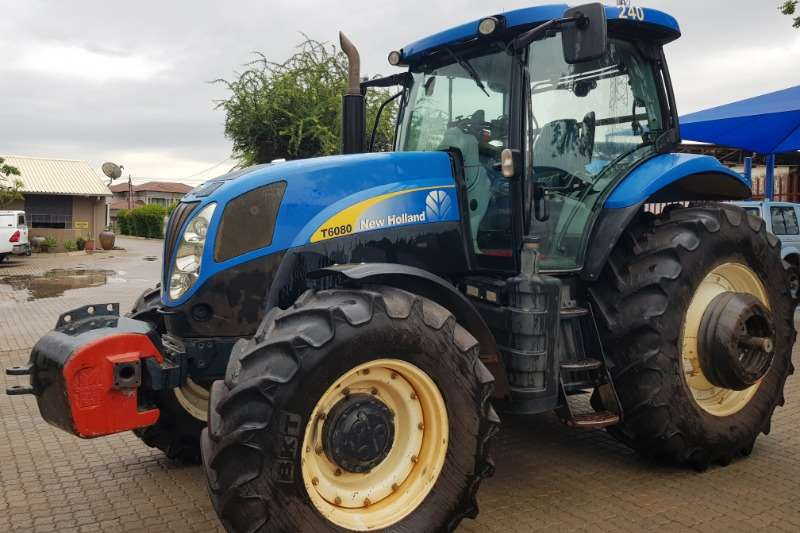 New Holland Four wheel drive tractors New Holland T6080 Cab with Raven GPS Tractors