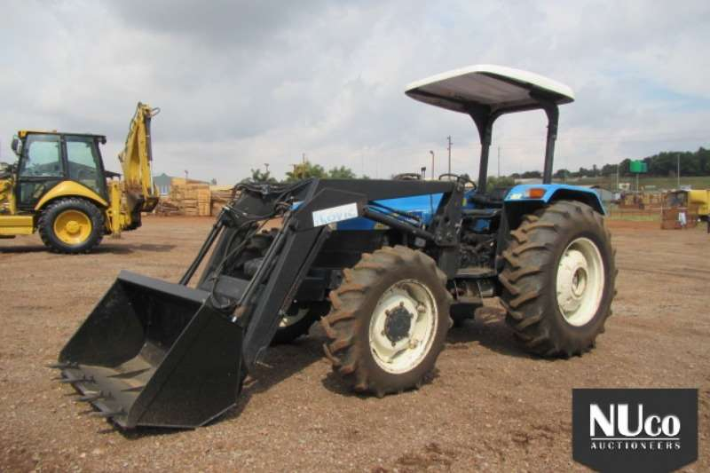 New Holland Tractors TT75 AWD TRACTOR WITH LOADER BUCKET