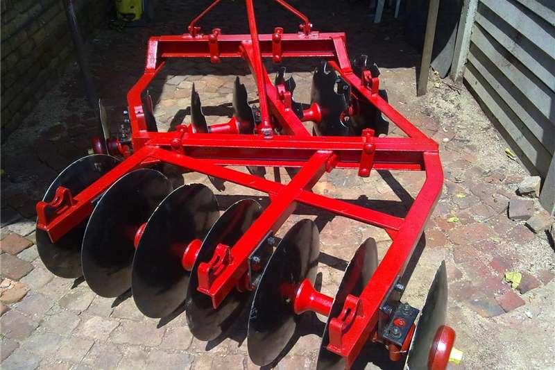 Ploughs Disc Harrows Massey Ferguson 14 disc harrow , 14 skottel dis