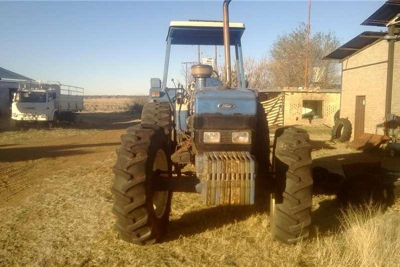 Four wheel drive tractors Ford 8340 SL  Tractor Tractors