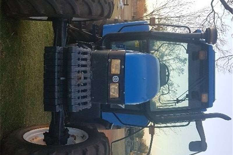 Four wheel drive tractors New Holland TS115 4x4 cab tractor for sale Tractors