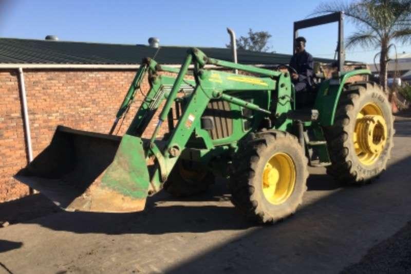 John Deere JD 6100d with fel Tractors