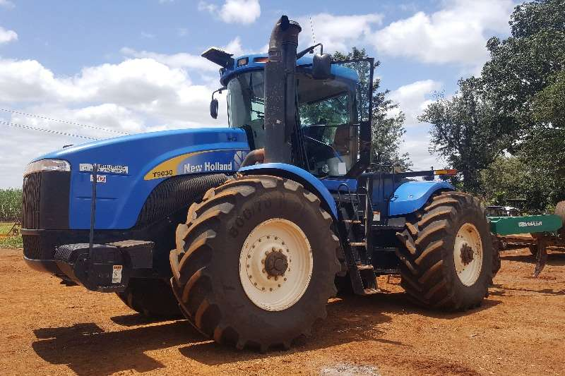 Tractors New Holland Four Wheel Drive Tractors New Holland T 9030 with Auto Guidance 2011