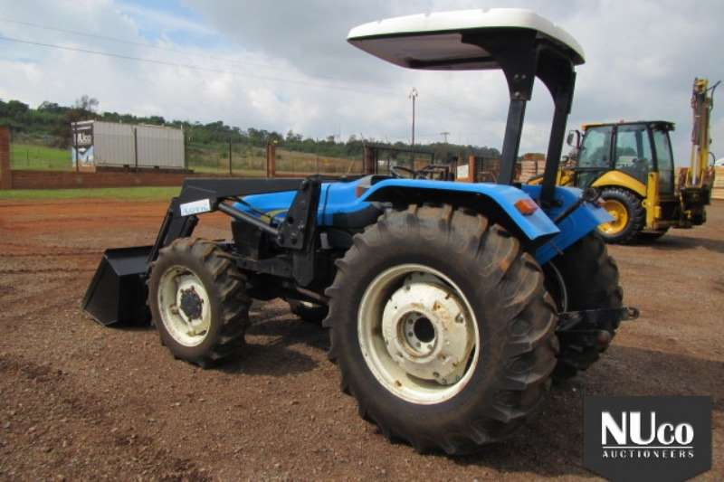 New Holland TT75 AWD TRACTOR WITH LOADER BUCKET Tractors