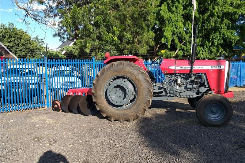 Two wheel drive tractors Massey Ferguson 290 with 3 disc pipe plough Tractors