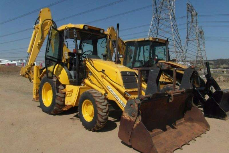 TLBs New Holland LB95 4 x 4 TLB With Fork Attachment 2004