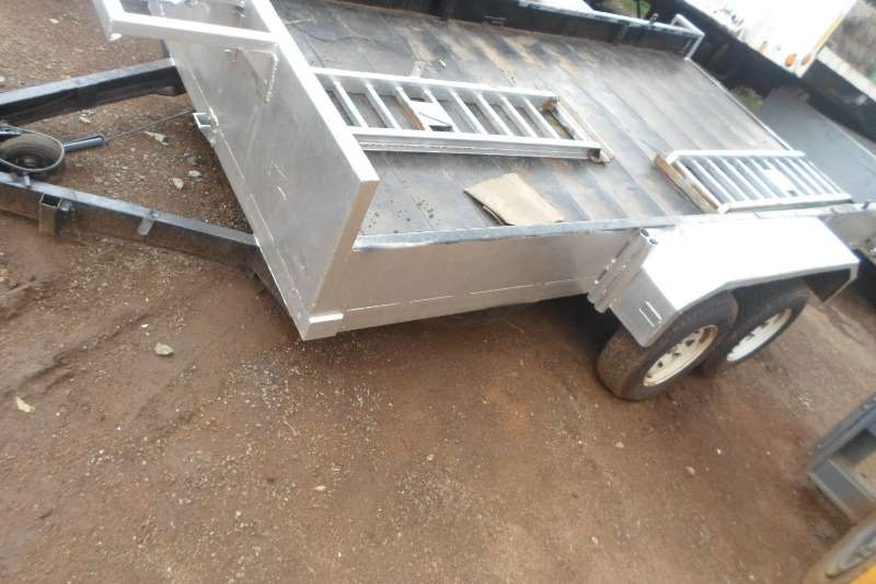 DOUBLE AXLE TRAILER WITH RAMPS