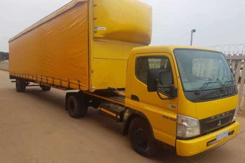 Fuso 2010 FUSO 6-109 4x2 TRUCK TRACTOR WITH TRAILER
