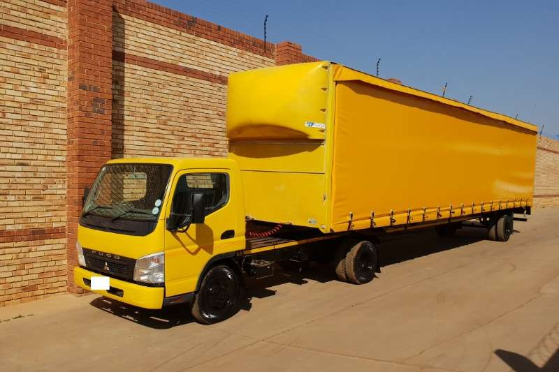 Fuso Truck-Tractor Single Axle FE6-109 PONI WITH LCM 12m TAUTLINER TRAILER 2010