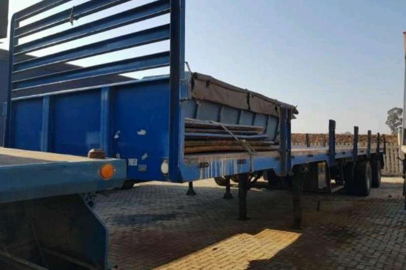 Hendred Flat deck Tri Axle trailers with dropsides included Trailers
