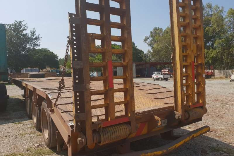 Henred 3 Axle Step deck trailer fitted rear loading ramps