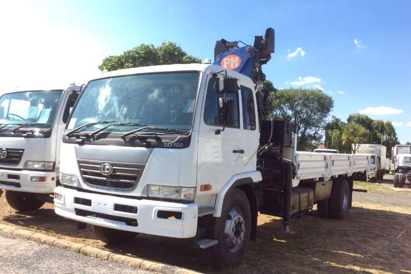 Nissan UD100 4x2 Dropsides with PM14 Crane