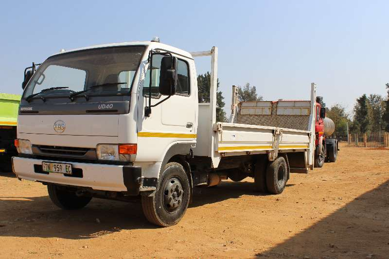 Truck Nissan Dropside Nissan UD 40 4 ton drop side with tail lift 0