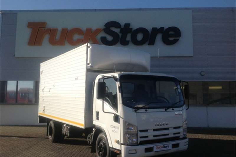 Truck-Tractor Isuzu NPR 400 AMT with flatdeck body Isuzu 2013