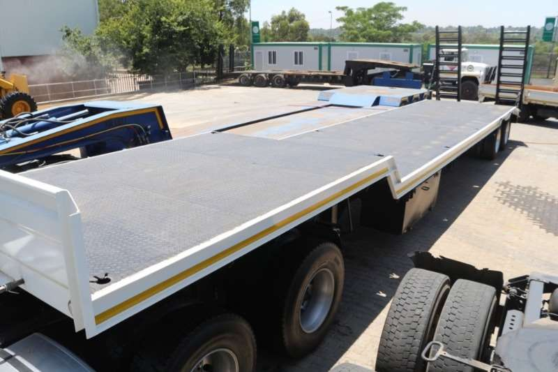 UBT Double Axle Step Deck Trailer with Ramps