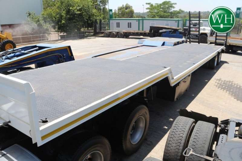 UBT Trailers Double Axle Step Deck with Rear Ramps 2017